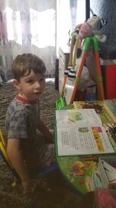 Чурсин Стефан изучает букварь